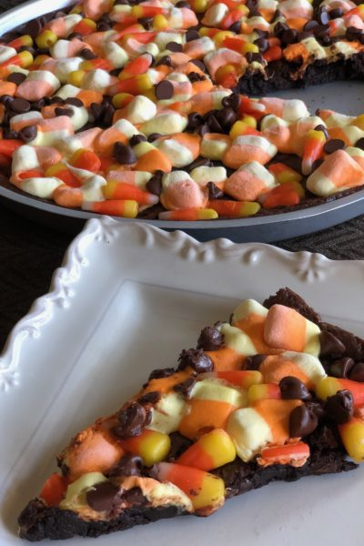 slice of candy corn brownie pizza on white plate