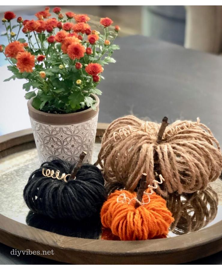 Three fall twine pumpkins and a mum