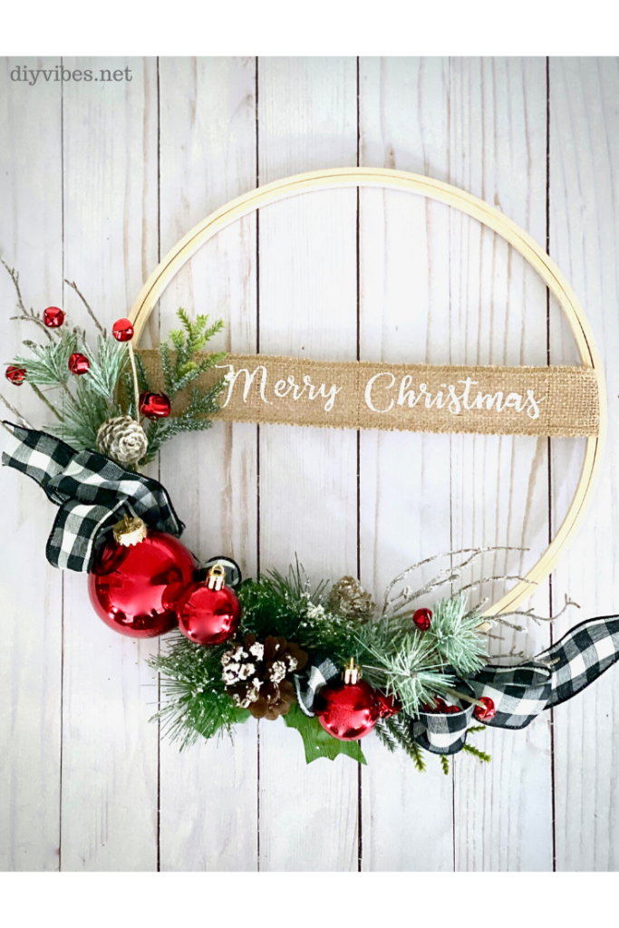 Christmas embroidery hoop wreath on white wood