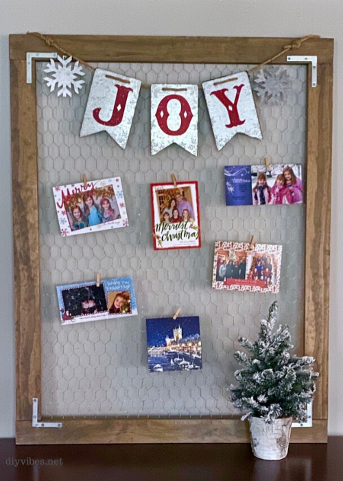 Christmas card display holder against a wall