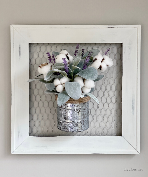 farmhouse wall decor on a gray wall